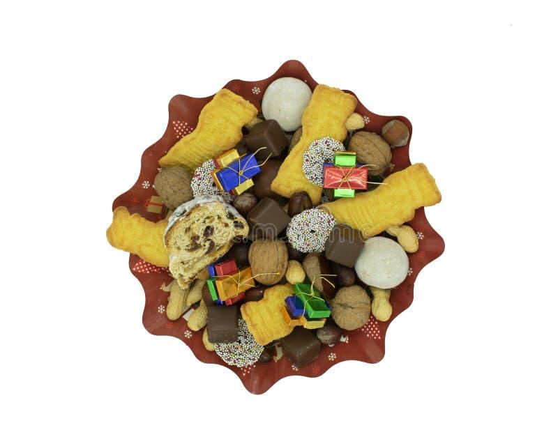 圣诞节板材与stollen,曲奇饼、巧克力和坚果 库存图片