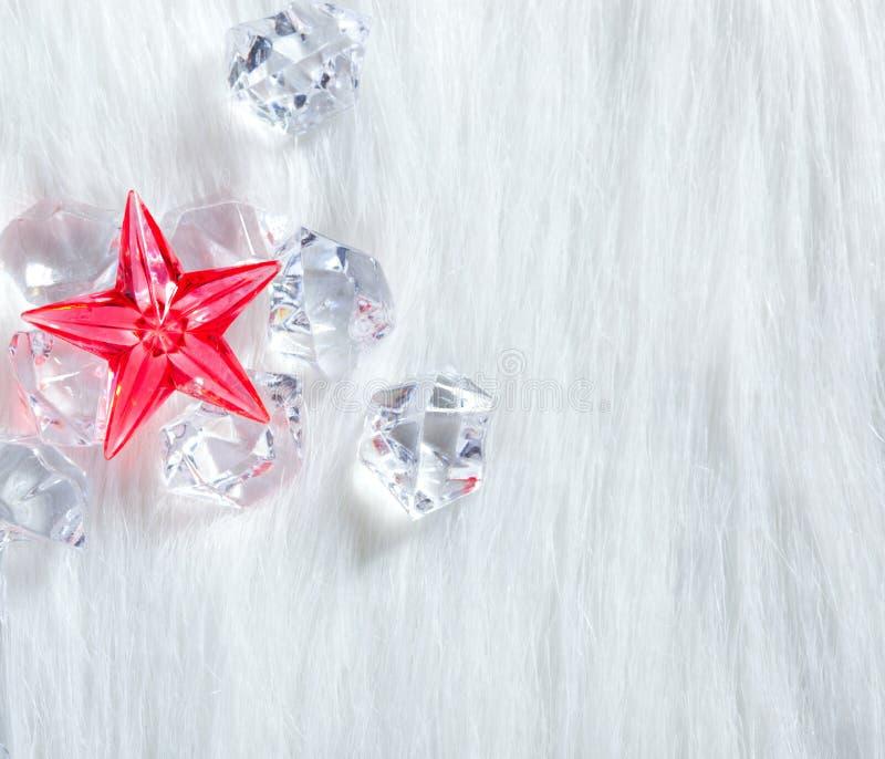 圣诞节水晶求毛皮冰红色星形的立方 免版税库存图片