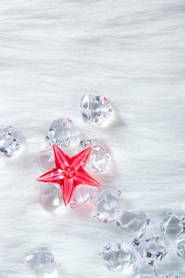 圣诞节水晶求毛皮冰红色星形的立方 库存照片