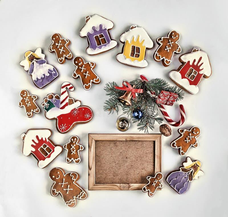 圣诞节烘烤,被隔绝的装饰,白色,您的文本的空的木制框架 顶视图,特写镜头,拷贝空间 库存图片