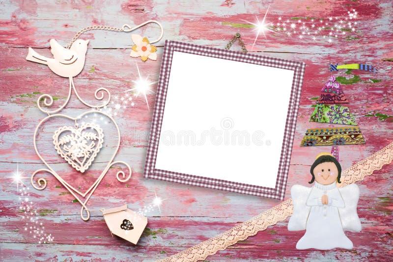 圣诞节照片女婴的框架卡片 免版税库存图片