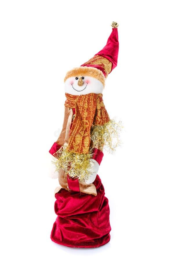 圣诞节玩偶:与帽子和围巾的雪人圣诞节装饰的 免版税图库摄影