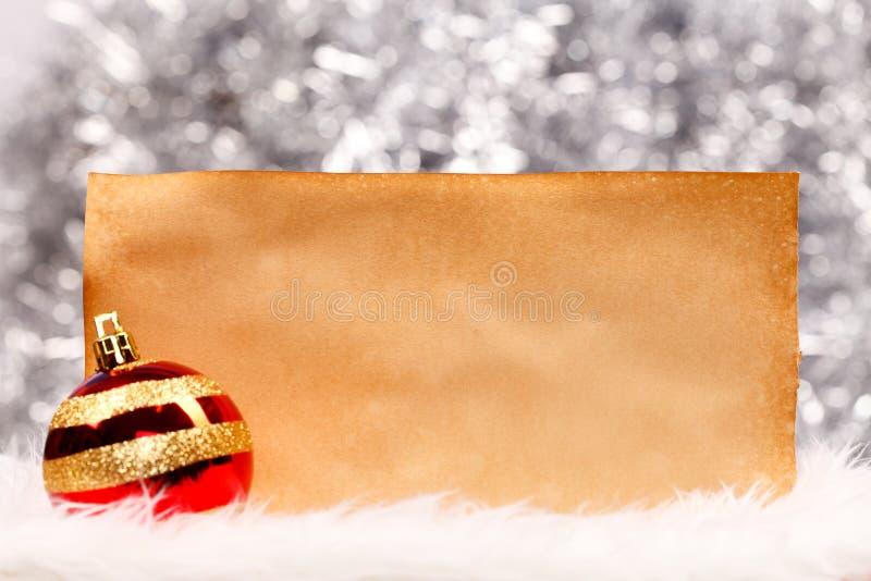 圣诞节球和葡萄酒纸 库存图片
