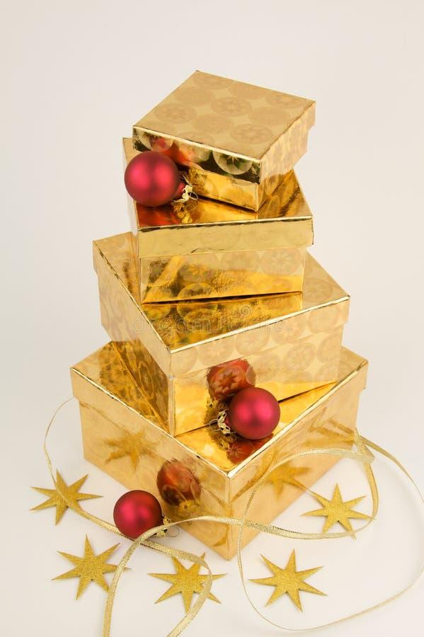 圣诞节礼品金子红色 库存图片
