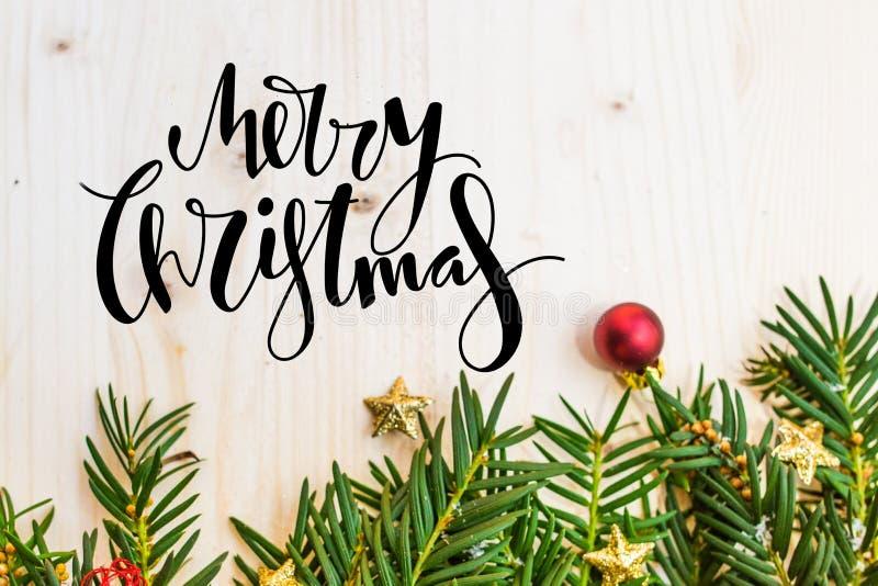 圣诞节祝愿与树叶子的背景 免版税库存照片