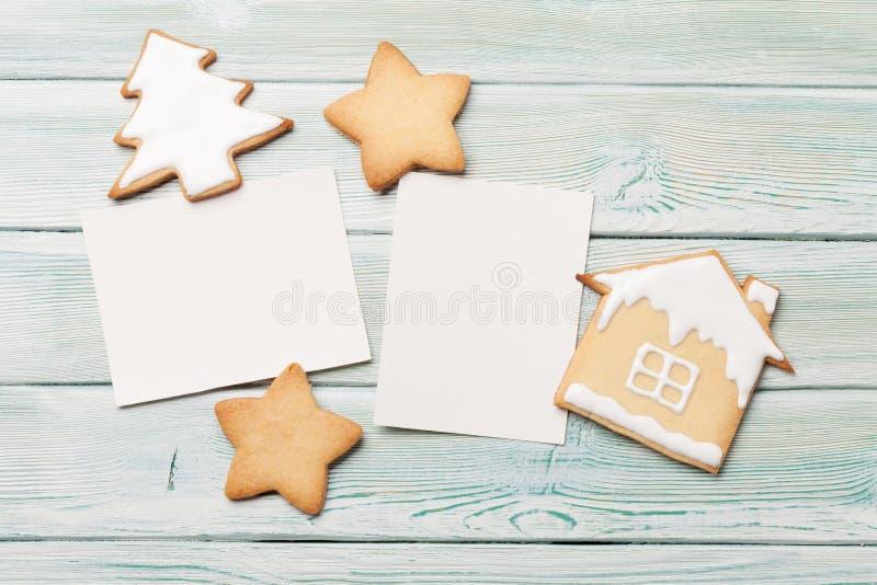 圣诞节空白的相框和姜饼曲奇饼 库存图片