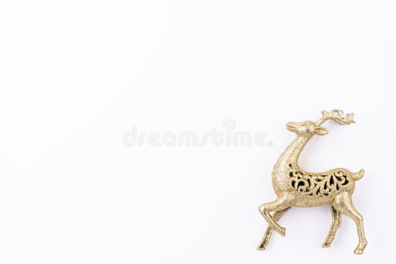 圣诞节背景概念 金黄驯鹿顶视图  免版税库存照片