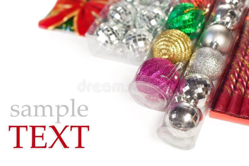 圣诞节装饰品被包装的范例文本 免版税库存照片