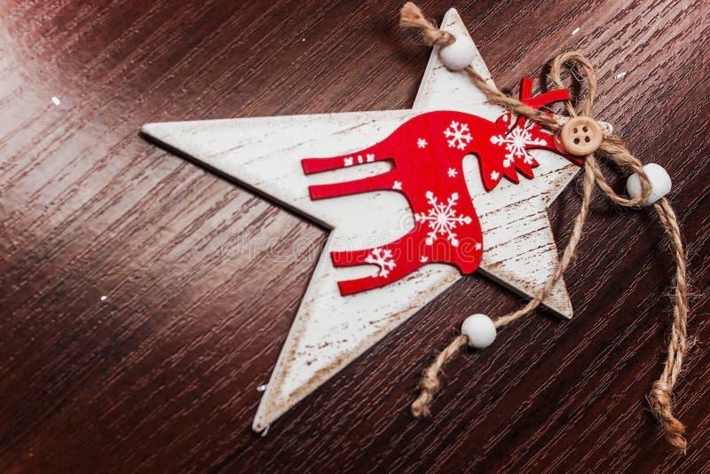 圣诞节装饰手工制造星鹿 免版税库存照片