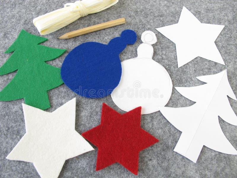 圣诞节装饰由毛毡制成 免版税库存照片