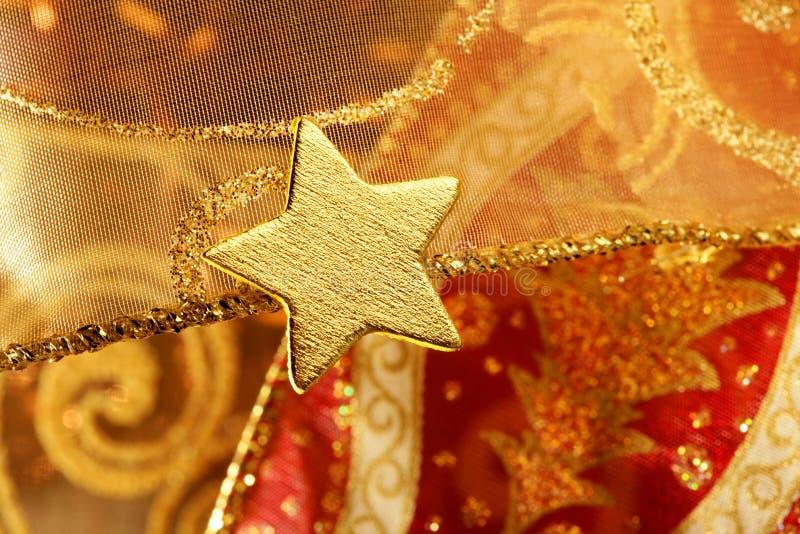 圣诞节装饰金金黄星形 免版税库存图片