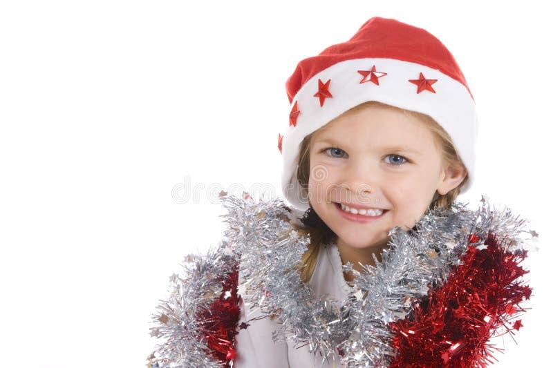 圣诞节逗人喜爱的女孩一点 库存图片