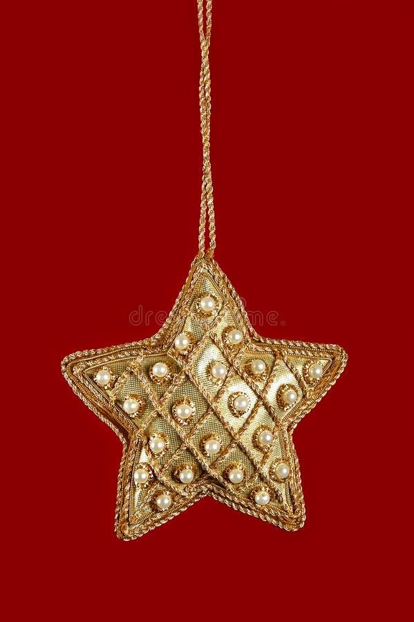 圣诞节金子成珠状星形 免版税库存照片