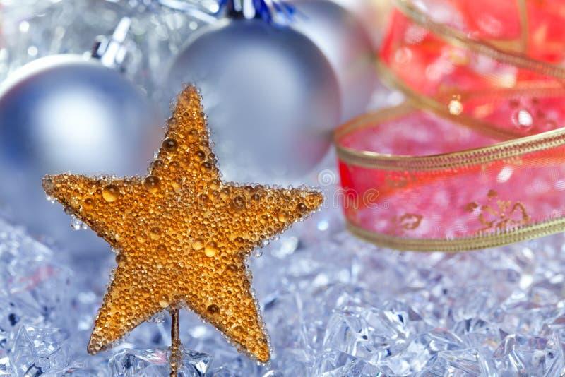 圣诞节金黄星形符号银中看不中用的物品 免版税库存照片