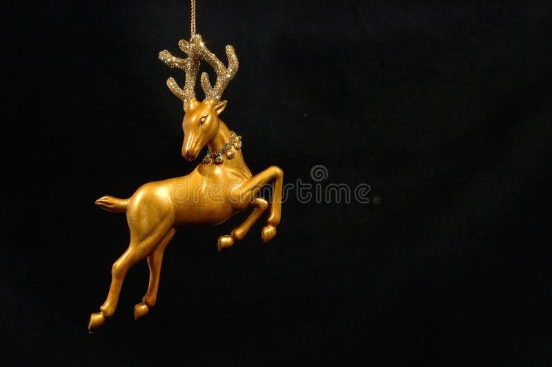 圣诞节金黄装饰品驯鹿 免版税库存图片