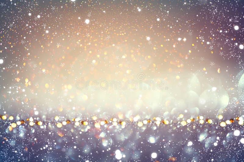 圣诞节金黄假日发光的背景 库存图片