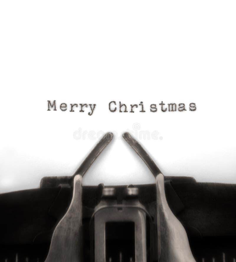 圣诞节问候被键入的打字机葡萄酒 免版税库存照片