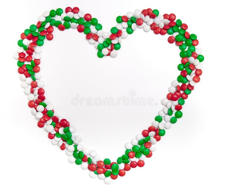圣诞节颜色巧克力糖的心脏  库存照片