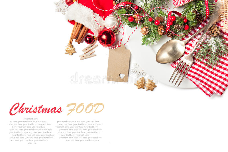 圣诞节食物概念-有叉子的有圣诞节装饰的板材和匙子 免版税库存图片