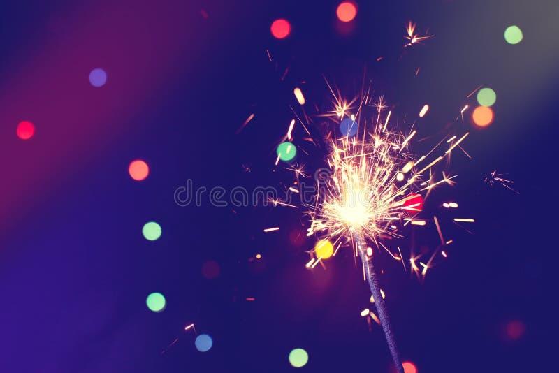 圣诞节,新年与闪烁发光物的摘要背景 免版税库存照片