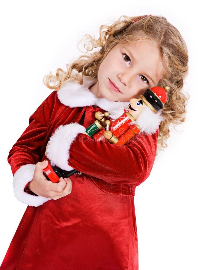 圣诞节:女孩拥抱胡桃钳A 免版税库存照片