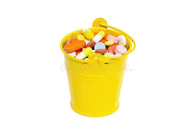 在一个小桶的药片 免版税库存图片