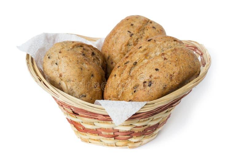 在一个小篮子的三个燕麦粥小圆面包 库存图片