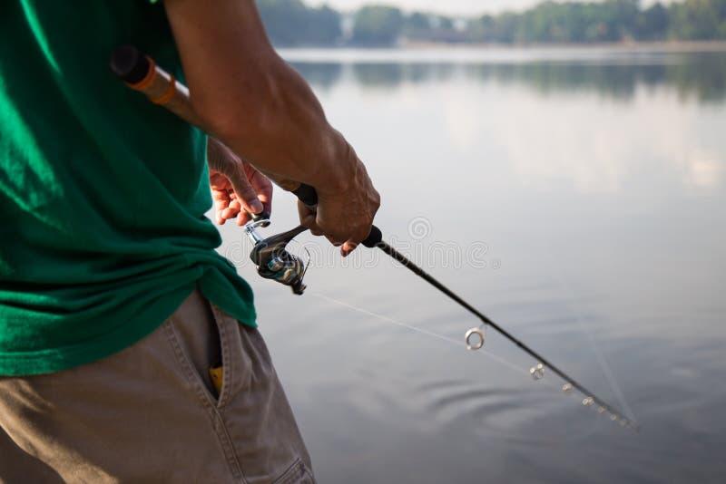 在一个平静的湖的消遣渔 图库摄影