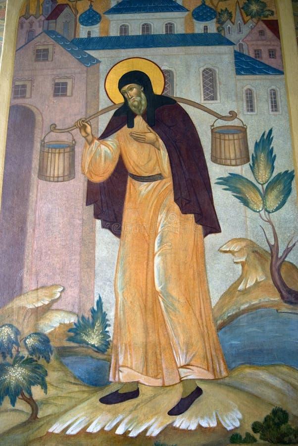 在一个教会门面的宗教绘画在三位一体Sergius拉夫拉在俄罗斯 颜色冬天照片 免版税库存图片
