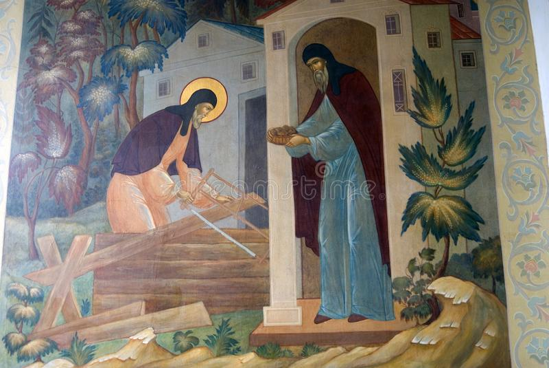 在一个教会门面的宗教绘画在三位一体Sergius拉夫拉在俄罗斯 颜色冬天照片 皇族释放例证