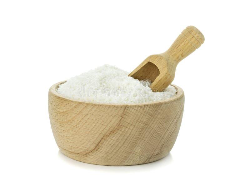 在一个木碗的被脱水的椰子 免版税库存图片
