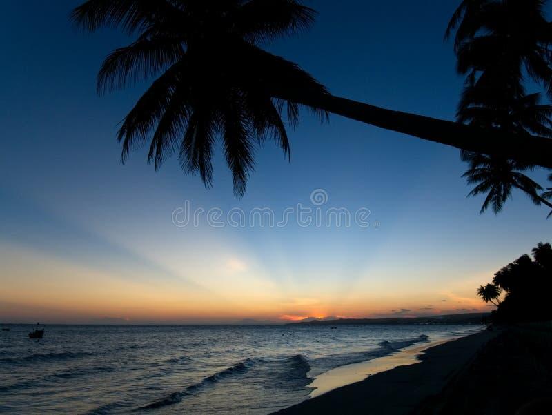 在一个海滩的日落在美奈 库存图片