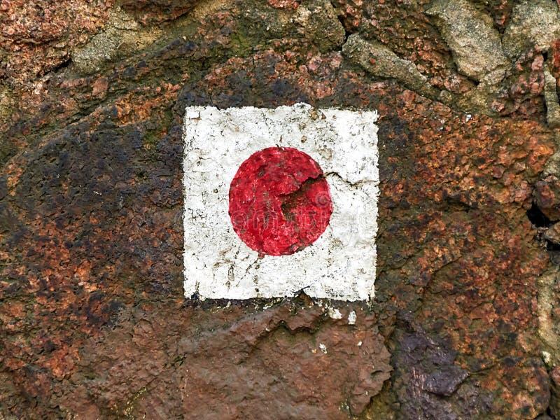 在一个猎物石墙的红色远足的标志标志在德国 免版税库存照片