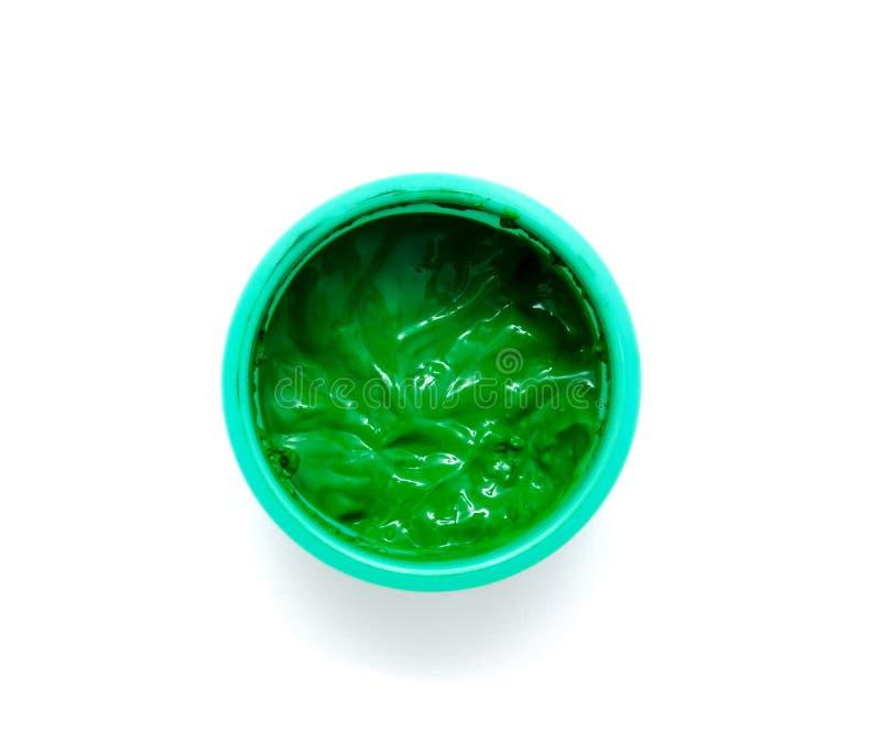 在一个瓶子的绿色油漆在白色背景 库存图片