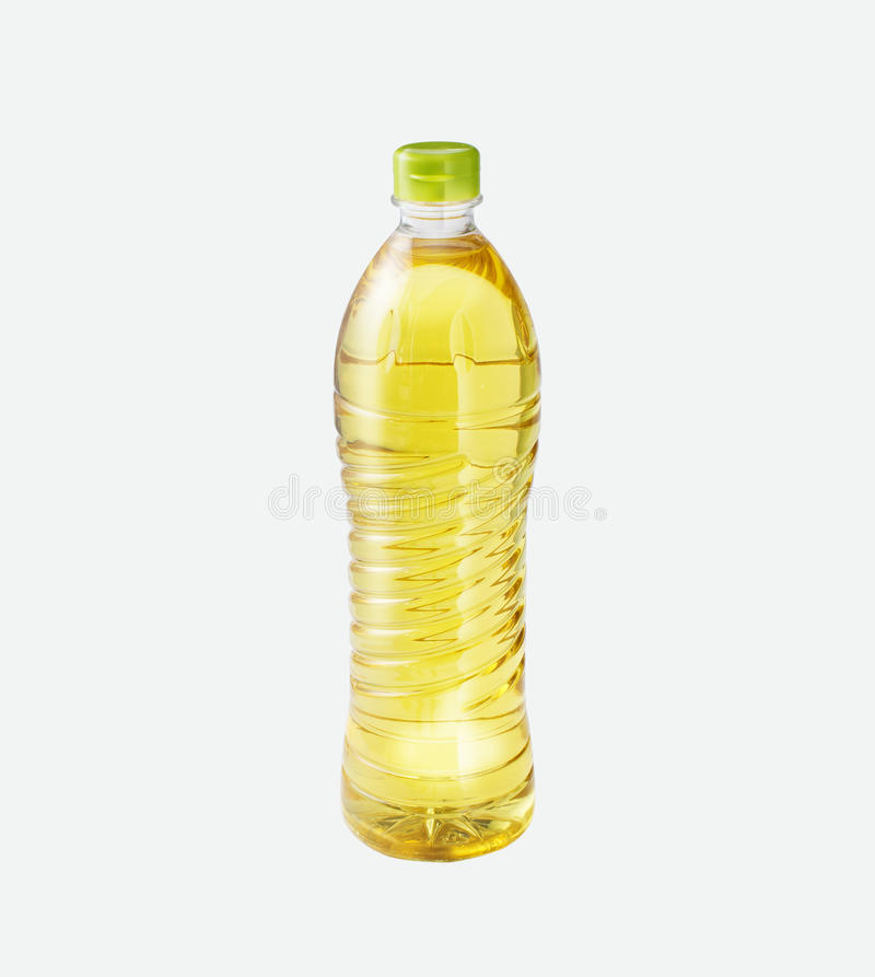 在一个瓶的米油在被隔绝的背景 免版税图库摄影