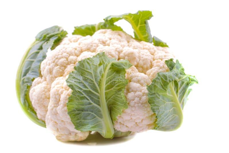 在一个白色背景特写镜头的新鲜的花椰菜 查出 免版税库存图片