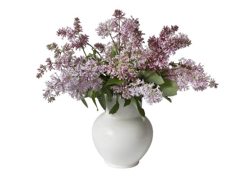 在一个白色花瓶的淡紫色花束 免版税库存照片