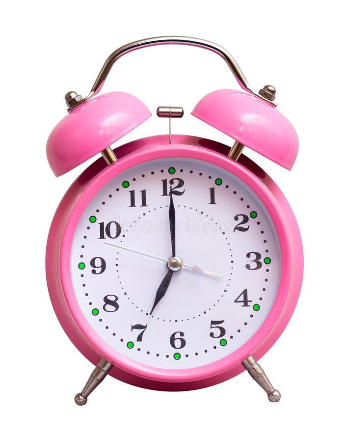 在一个白色被隔绝的背景展示的桃红色时钟7个小时 免版税库存图片
