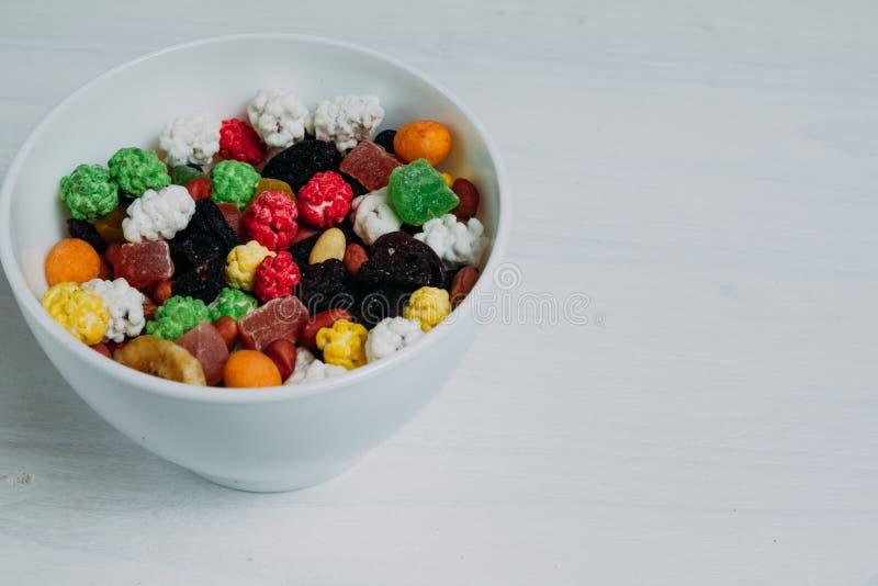 在一个碗的干果子在桌上 免版税库存照片