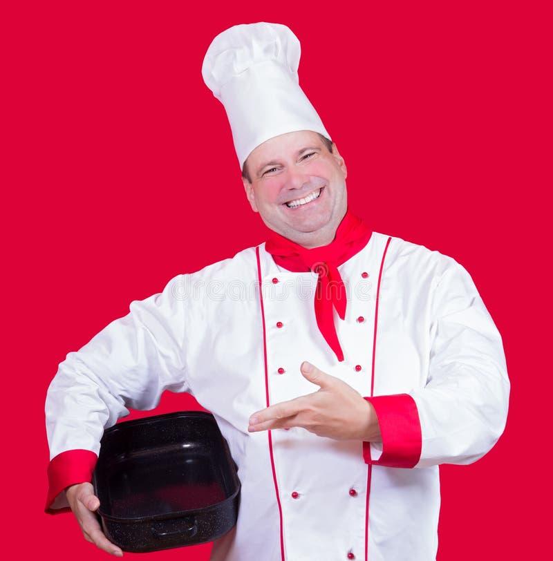 在一个空的烤盘的厨师展示 图库摄影