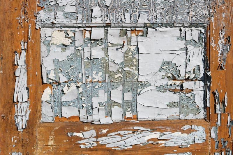 在一个老木门的破裂的油漆类似一抽象painti 库存图片