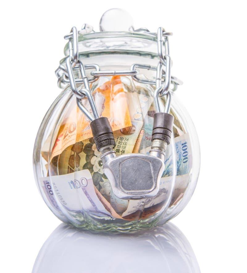 在一个被束缚的瓶子IV的金钱 库存图片