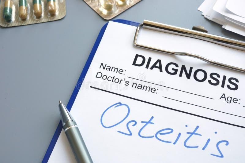 在一个诊断形式写的诊断osteitis 免版税库存图片