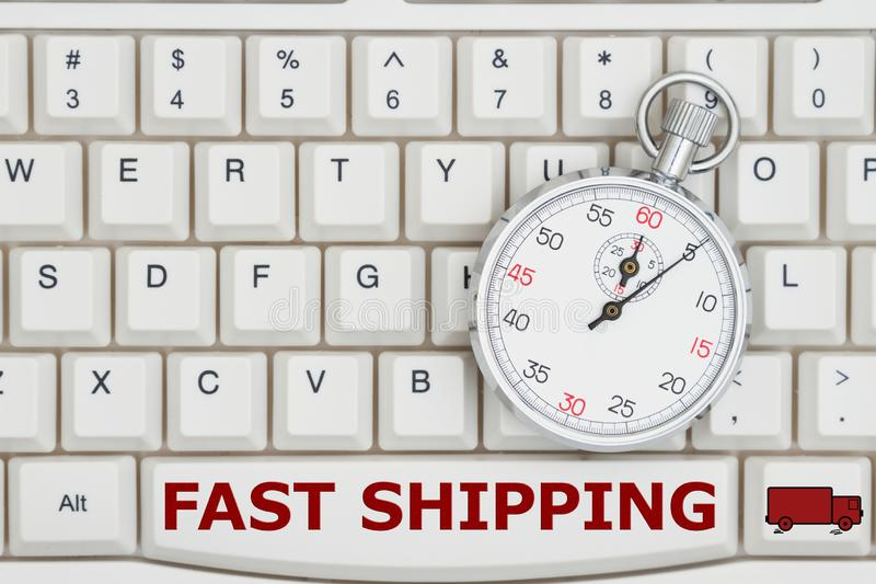 在一个键盘的秒表有文本快速的运输和卡车的 库存图片