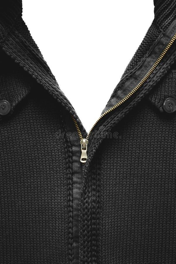 在一件黑被编织的毛线衣的被解扣的黄色拉链 图库摄影