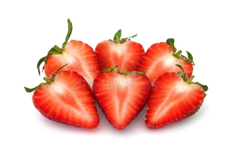 在一半切的新鲜的草莓果子片断,在白色背景 库存照片