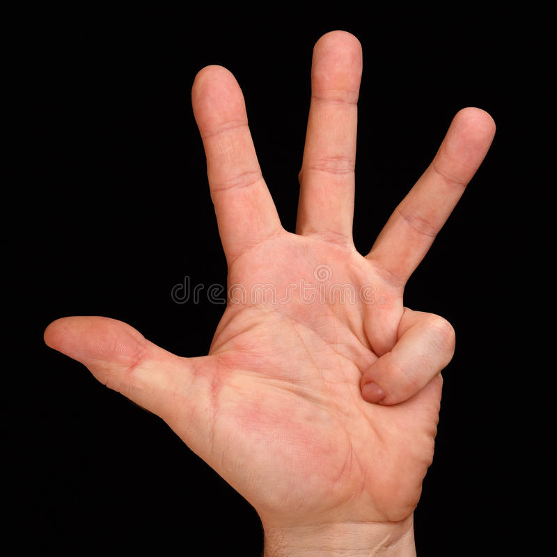 在一只男性手上的四个手指 免版税库存图片