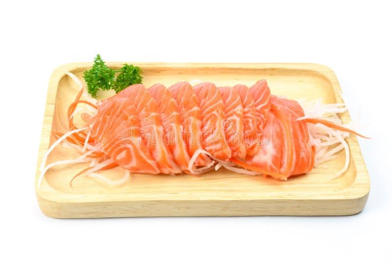 在一块木板材的三文鱼生鱼片 免版税库存图片