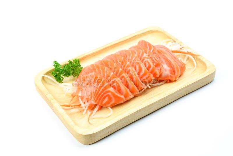 在一块木板材的三文鱼生鱼片 免版税库存照片
