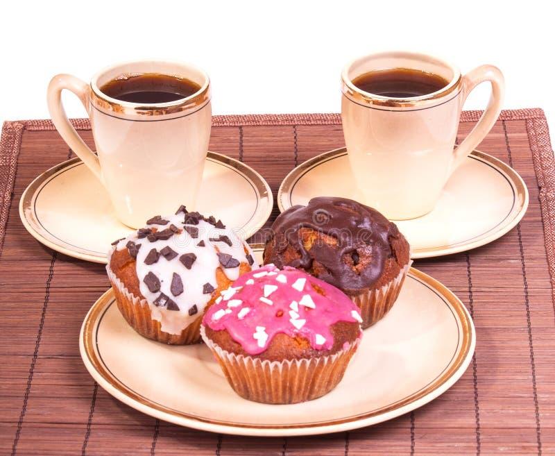 咖啡在板材的和松饼 库存图片